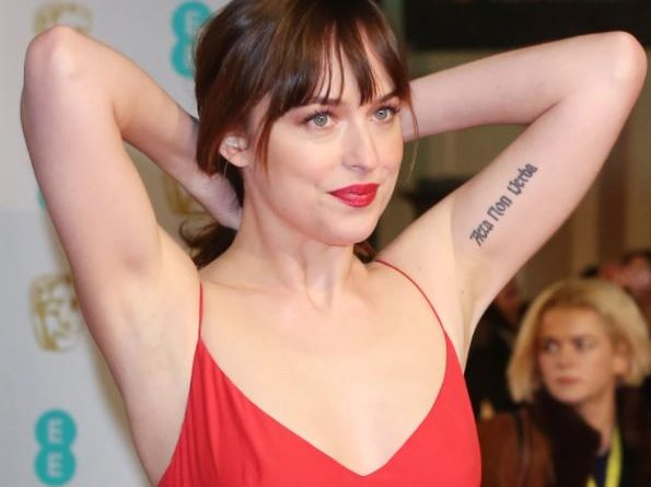 Dakota Johnson arm, elbow and bicep tattoos